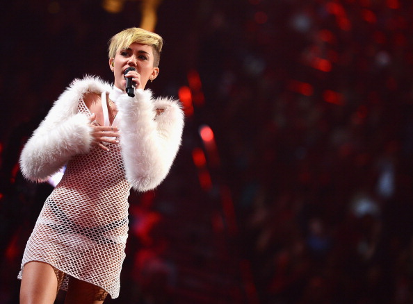 LAS VEGAS, NV - SEPTEMBER 21:  Entertainer Miley Cyrus performs onstage during the iHeartRadio Music Festival at the MGM Grand Garden Arena on September 21, 2013 in Las Vegas, Nevada.  (Photo by Mark Davis/Getty Images for Clear Channel)
