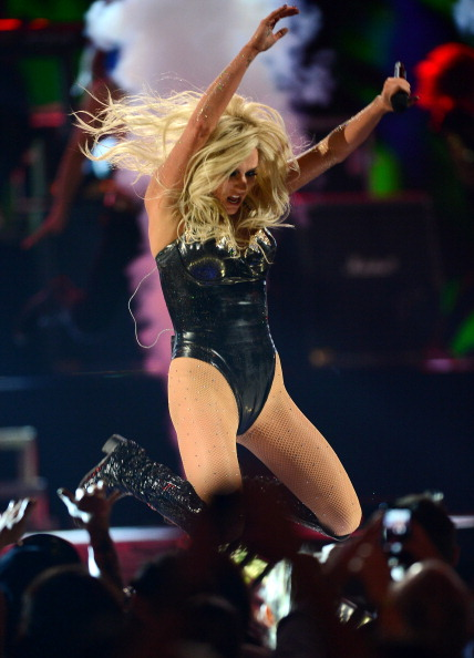 LAS VEGAS, NV - SEPTEMBER 21:  Singer Ke$ha jumps as she performs during the iHeartRadio Music Festival at the MGM Grand Garden Arena on September 21, 2013 in Las Vegas, Nevada.  (Photo by Ethan Miller/Getty Images for Clear Channel)