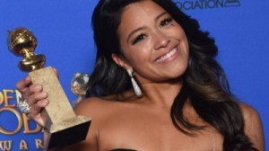 """Actress Gina Rodriguez holds the award for Best Actress - TV Series, Comedy or Musical for her role in """"Jane the Virgin, in the press room at the 72nd annual Golden Globe Awards, January 11, 2015 at the Beverly Hilton Hotel in Beverly Hills, California. AFP PHOTO / FREDERIC J BROWN (Photo credit should read FREDERIC J. BROWN/AFP/Getty Images)"""